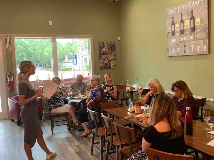 Group Meeting While Drinking Wine