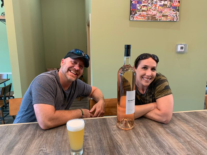 Couple With Branded Bottle of Wine